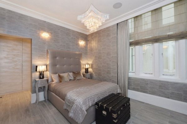 a custom, built-in wardrobe and an en-suite bathroom in luxury bedroom in Knightsbridge, London