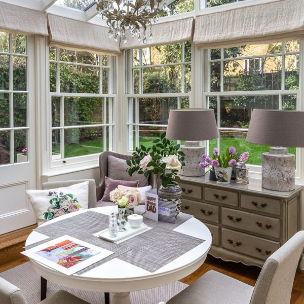 sunroom with traditional, elegant interior design in grade II house in St john's wood, London