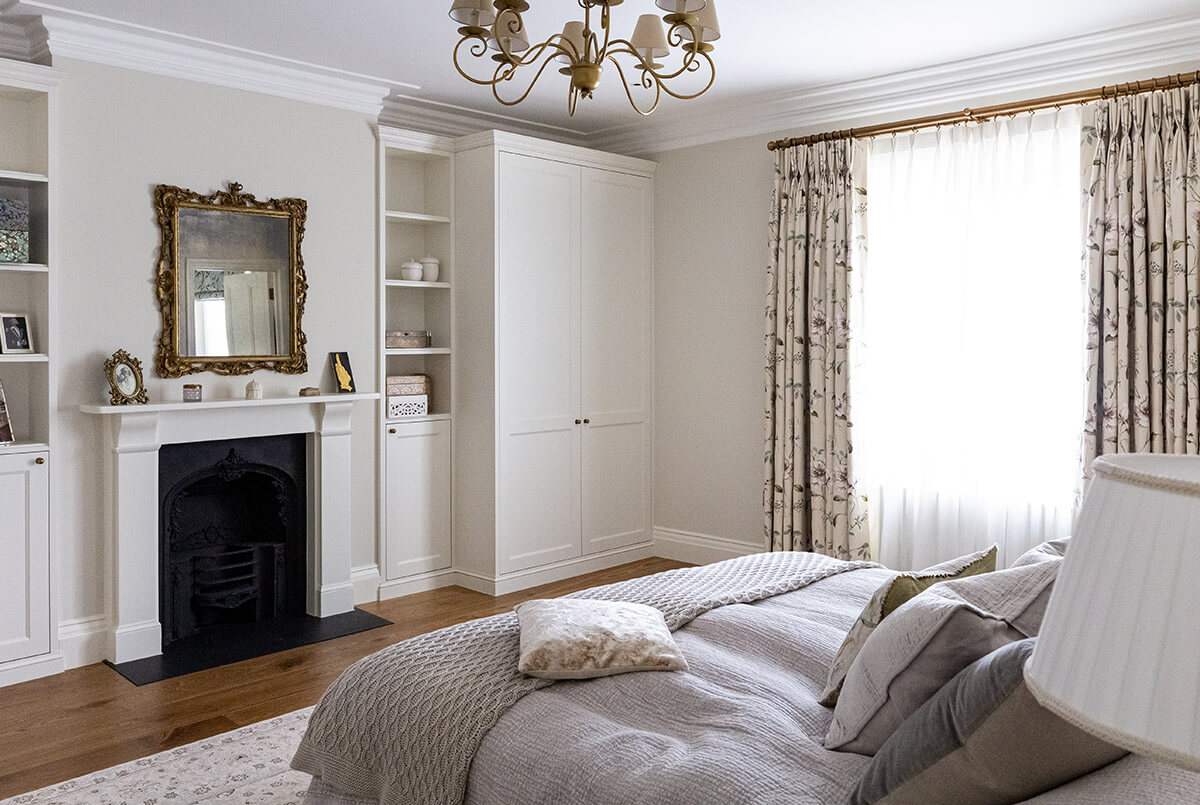 residential interior design for elegant bedroom with firepalce and antique decor in victorian style in St John's wood, London