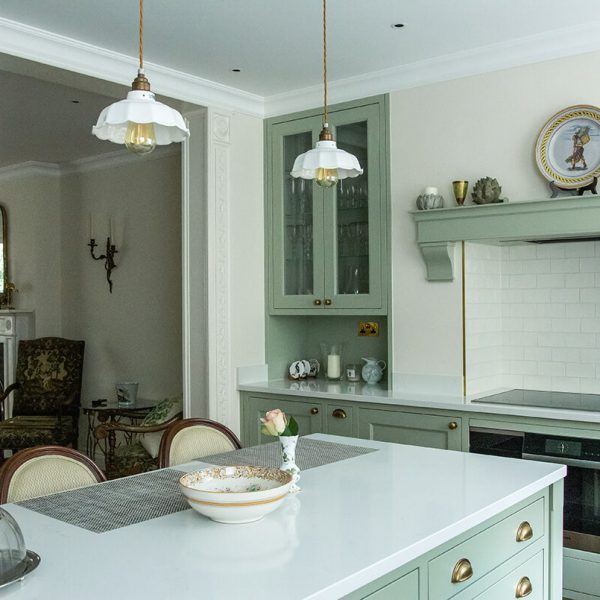 residential interior design for kitchen with soft green cabinets in Grade II listed house in St John's Wood, London