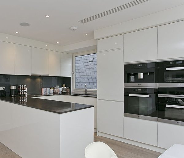grand and spacious interior design for open plan light kitchen and living room with dining area and custom made bespoke furniture in Swiss Cottage, London.