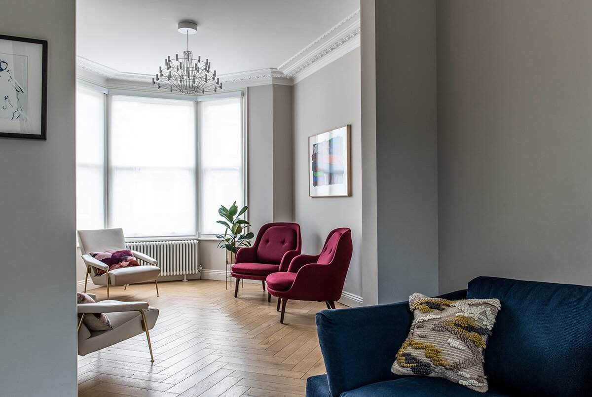 residential interior design for luxury living room with burgundy armchairs and blue sofa in Bromley, London