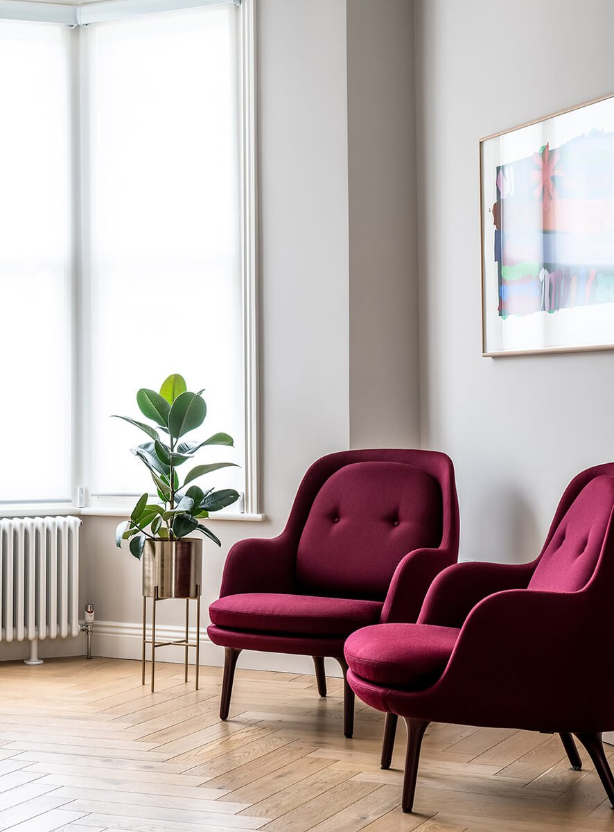 residential interior design for luxury living room with burgundy armchairs in Bromley, London