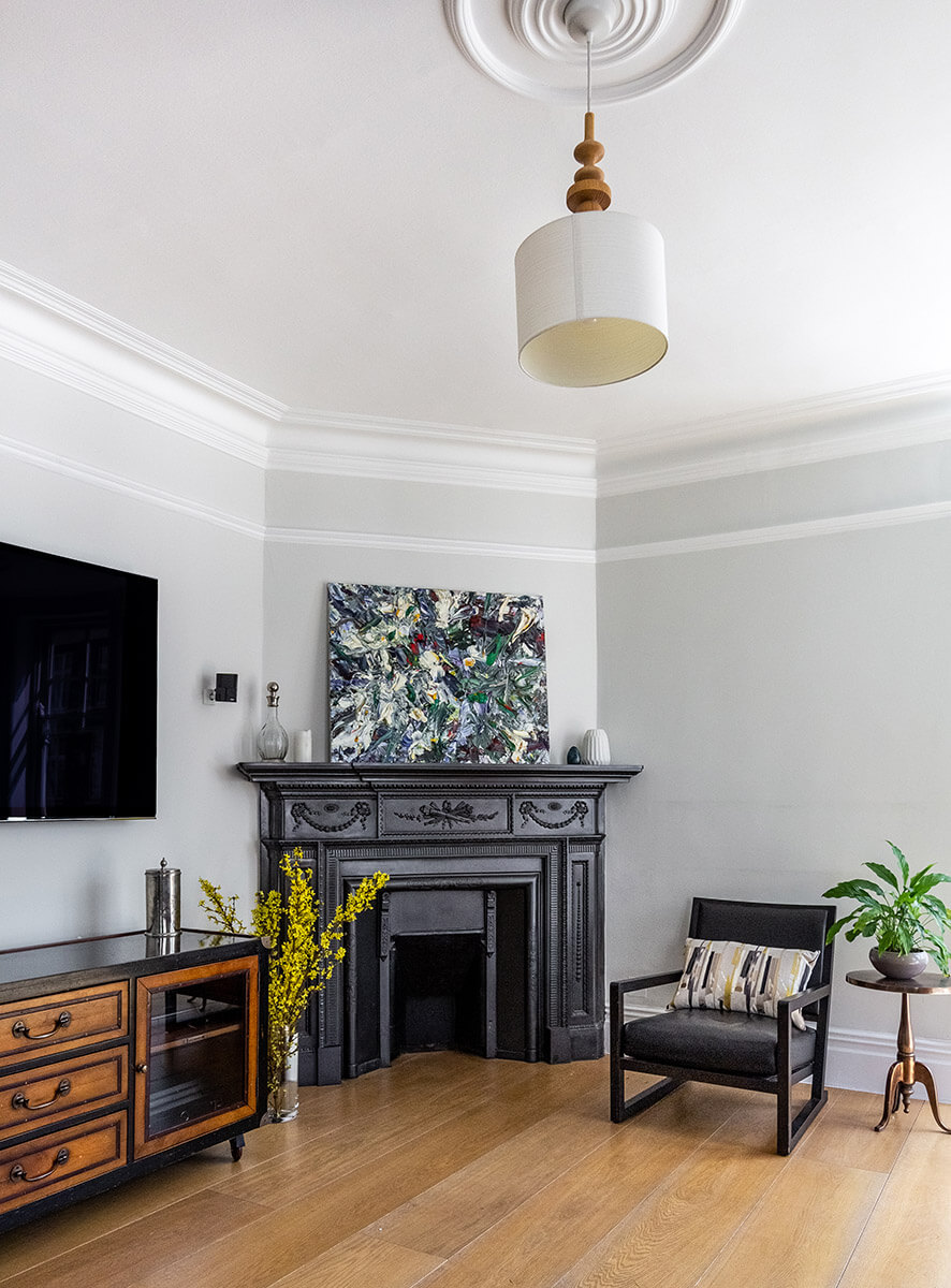 design and build-white painted living room with fireplace, brown leather sofa, chair and dresser in Marylebone, London