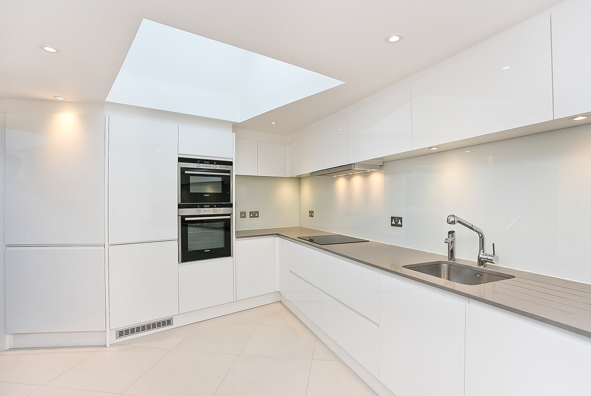 grand and spacious interior design for light kitchen with custom-made white cabinets in south kensington, London