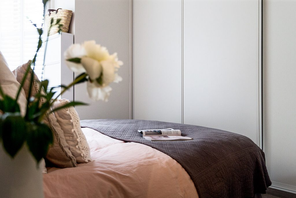 residential interior design for elegant and minimalist master bedroom with massive build in wardrobe in Hampstead, London