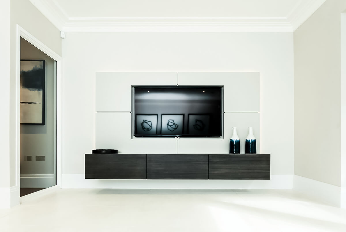 Minimalistic spacious light sitting room with bespoke suspended tv unit and contemporary interior features.