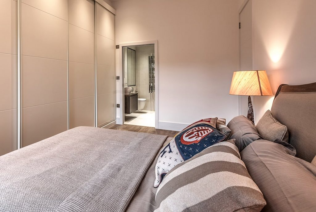 residential interior design for light Master bedroom an en-suite and large storage space in South Kensington, London