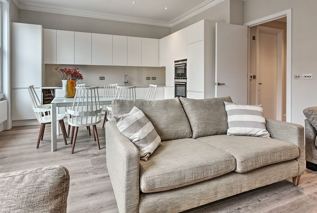 modern and luxury interior design for open plan kitchen and living area with bespoke joinery elements in south kensington london