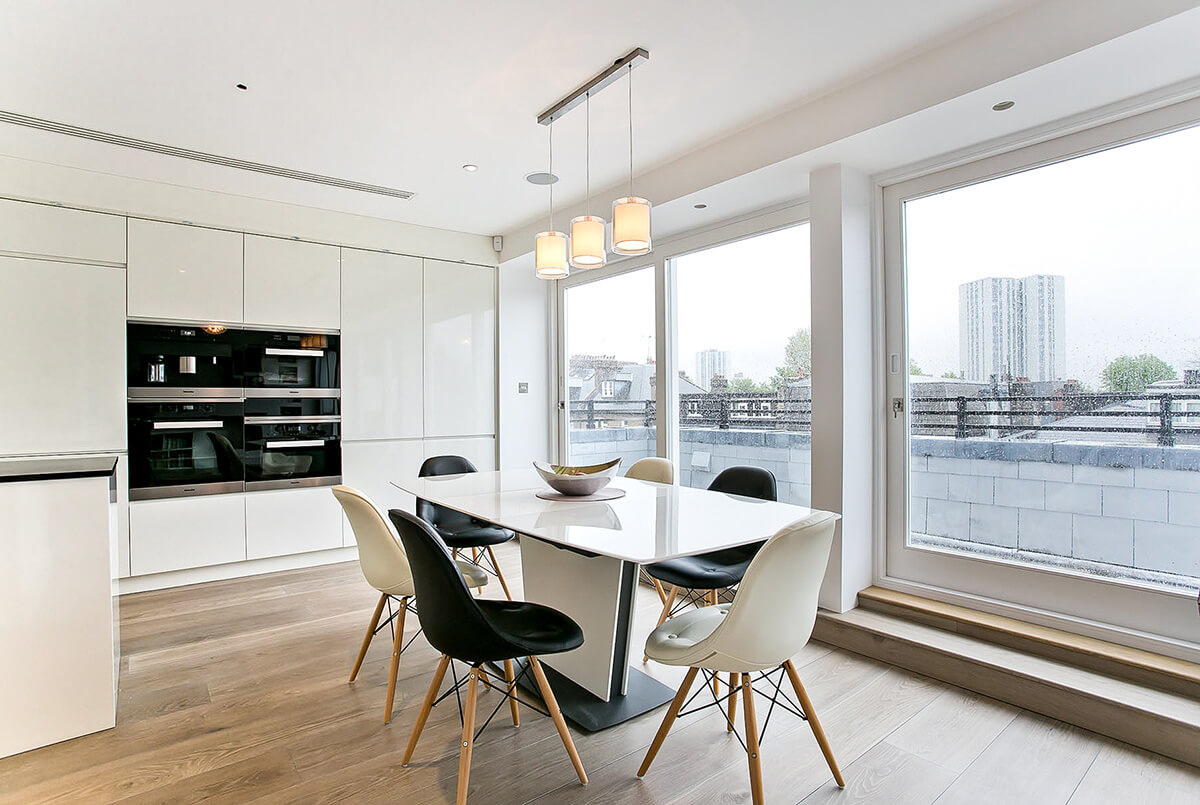 grand and spacious interior design for light kitchen with dining area and custom made bespoke furniture in Swiss Cottage, London.