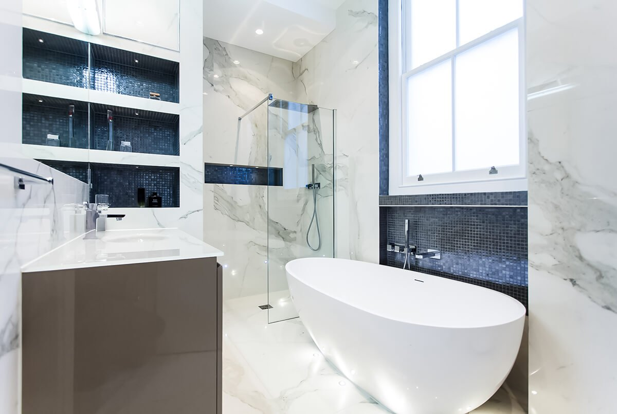 luxury interior design for black and white bathroom with free standing bath, alcoves, marble walls in Kensington, London