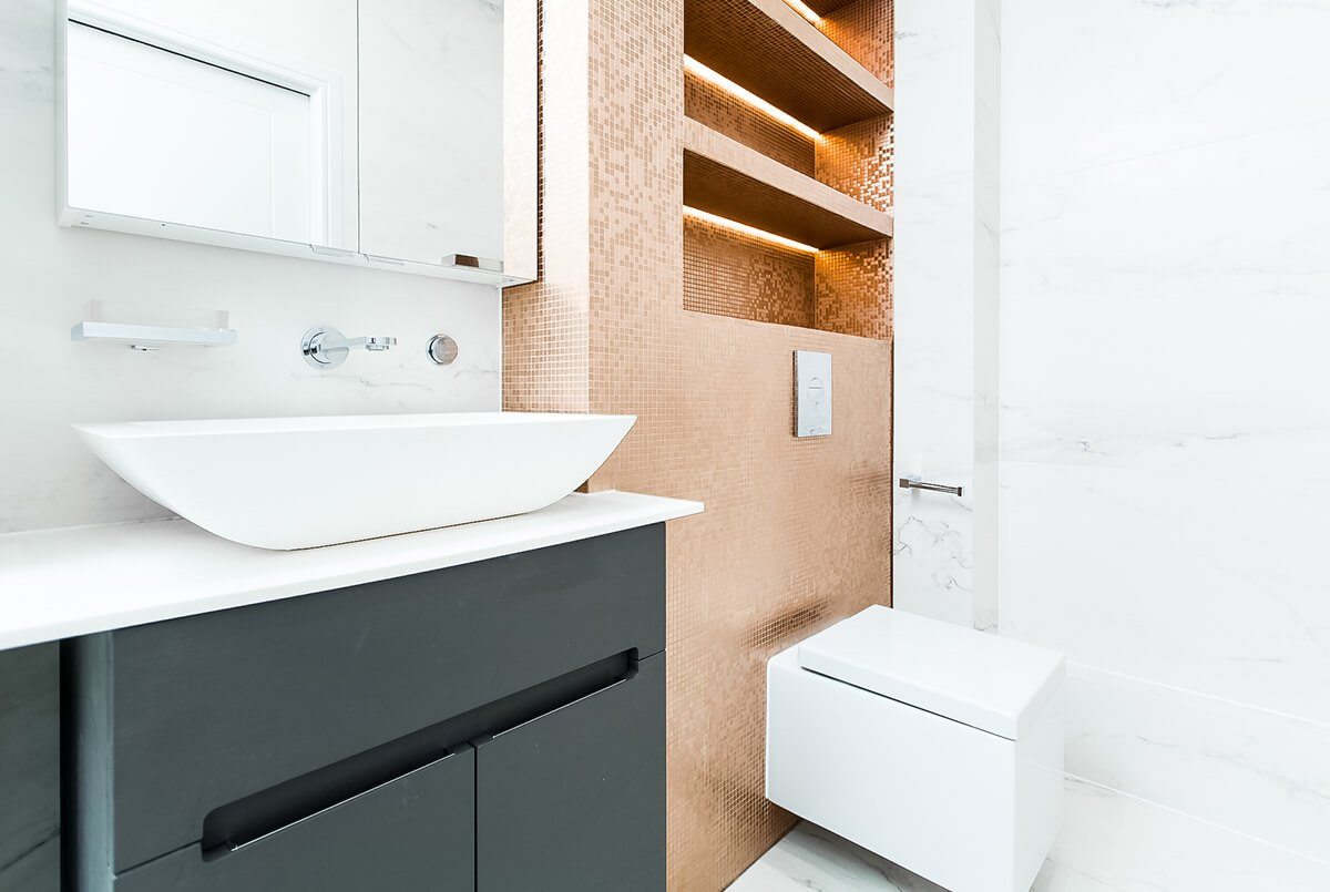 stylish and luxurious bathroom with gold tiles in Westmintser, London