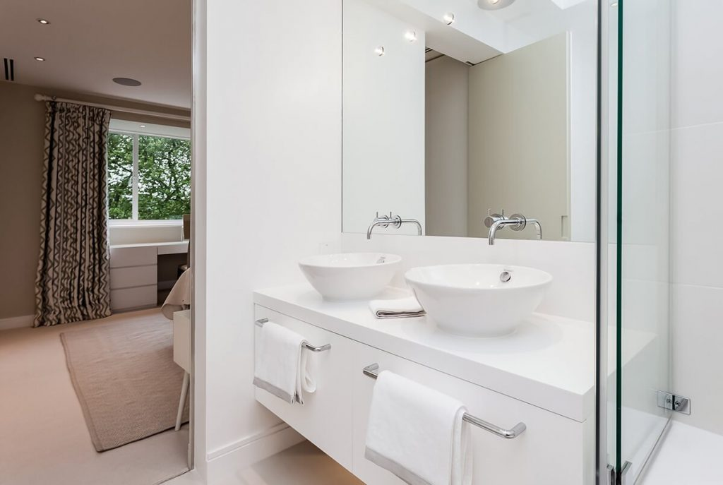 spacious light bathroom with two sinks and large wall mirror, Chelsea, London