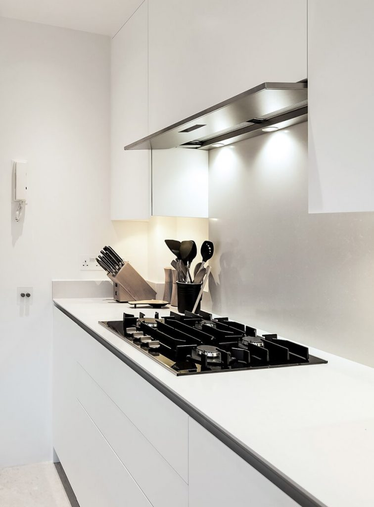 small yet practical kitchen with bespoke white cabinets, Chelsea, London
