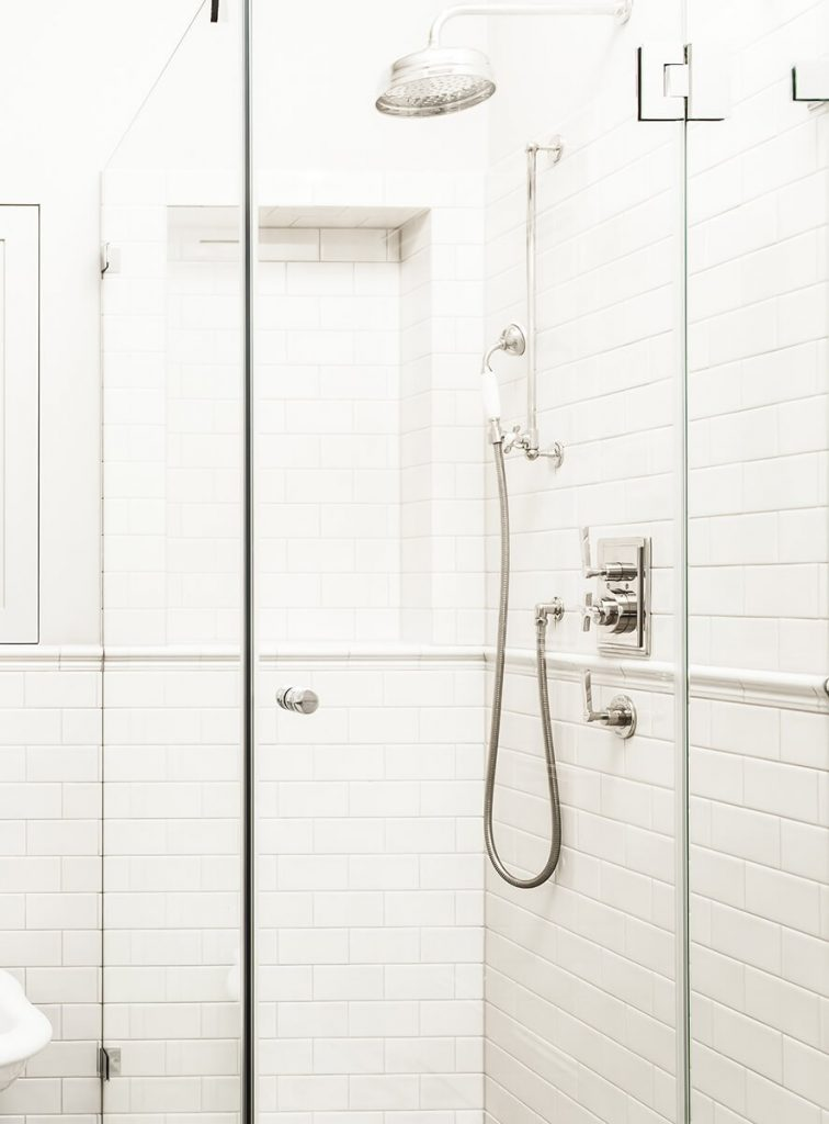 monochrome white bathroom with shower stall in Shepherds bush, London
