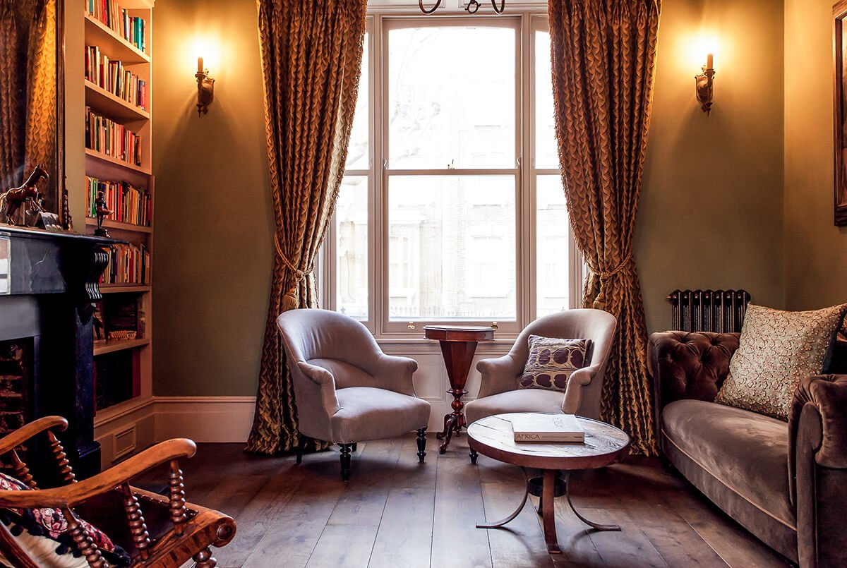 residential interiro design for a dreamy livingroom in Victorian style with cosy velvet furniture, bookcase in Shepherd's Bush, London