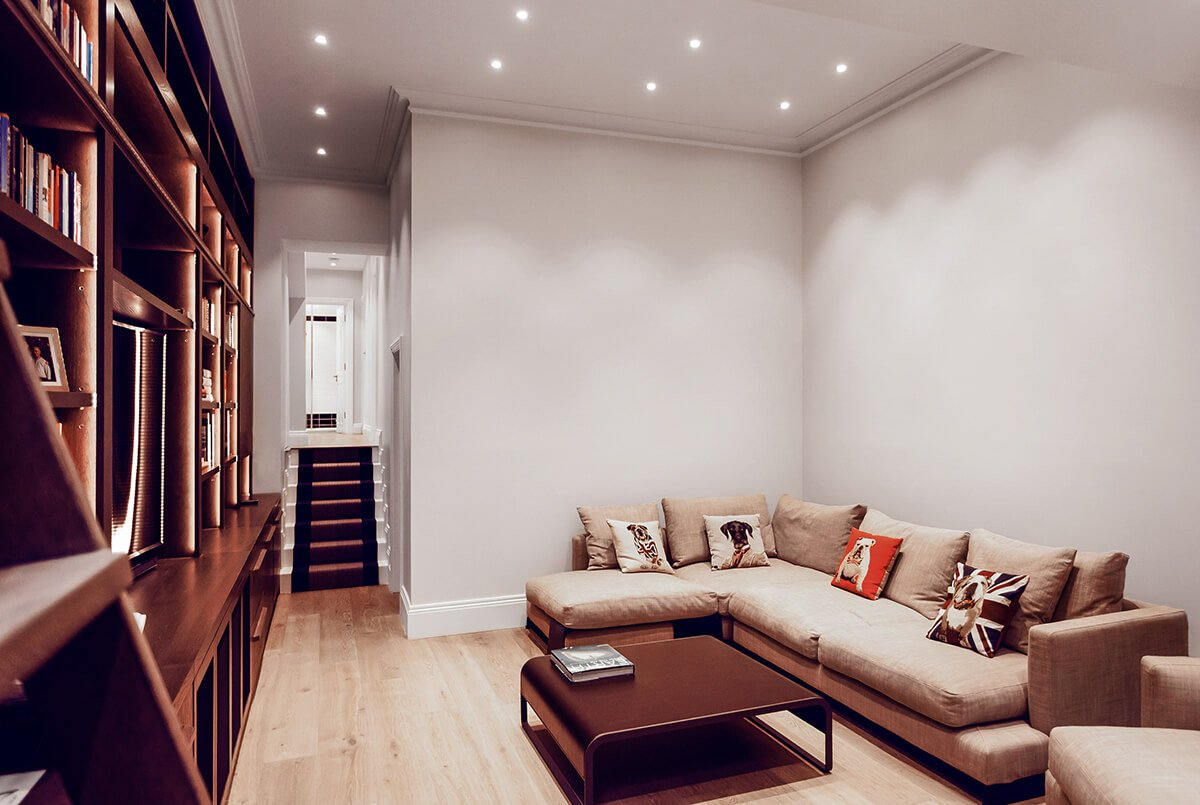 residential interior design for spacious media room with bespoke furniture in Chelsea London