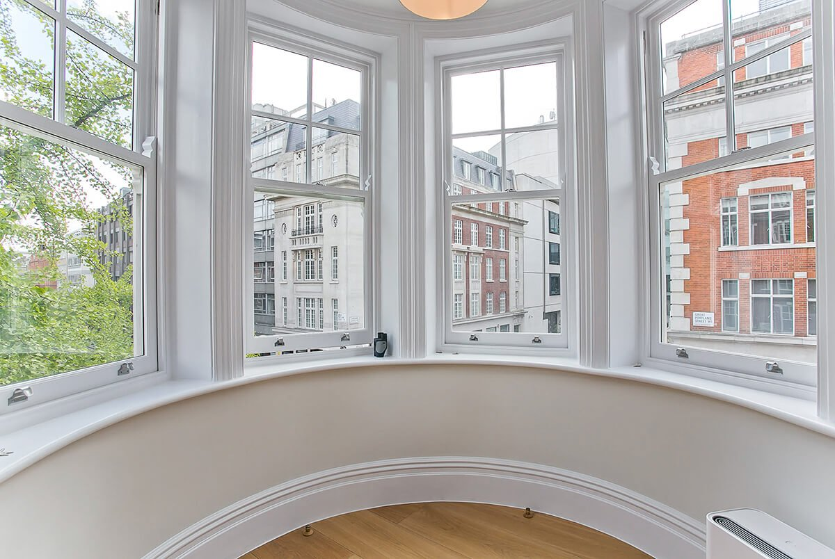 residential interior design with large bay window in Marylebone, London