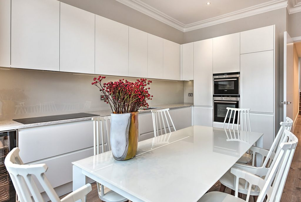 residential interior design for light and spacious kitchen with dining area, custom made cabinets in South Kensington, London