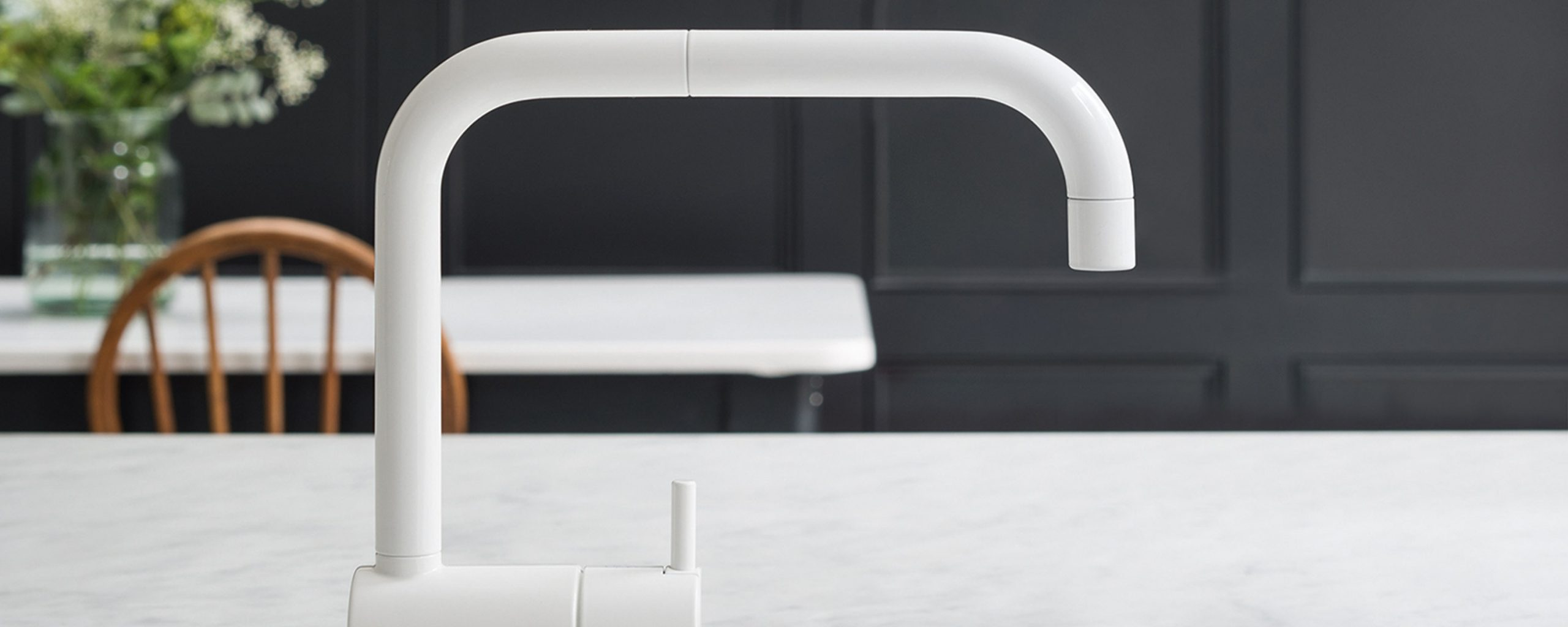 black and white kitchen with white faucet