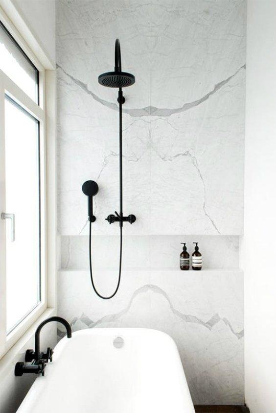 Interior design for white bathroom with black brassware finish designed by Donbracht