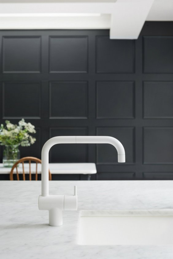 black and white kitchen with beautiful kitchen white faucet finish designed by Arne Jacobsen for VOLA