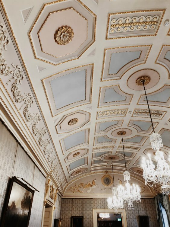 beautiful ceiling in neutral colour palette with luxury chandaliers