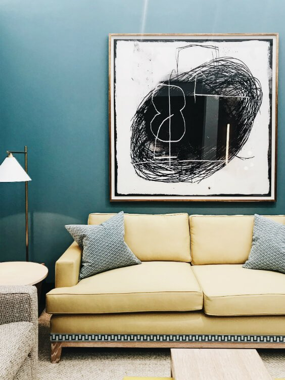bright interior design for living room with blue walls,, yellow sofa