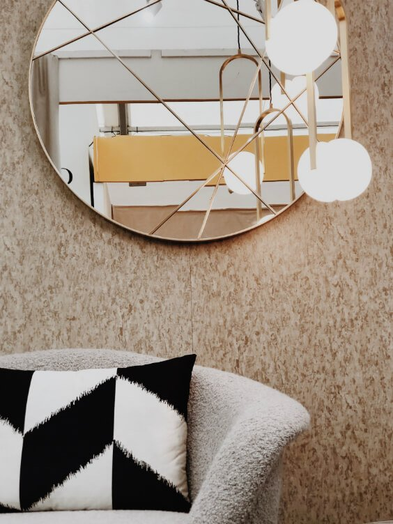 interior design in neutral palette with round mirror