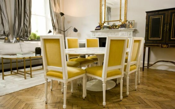 interior design for dining room with round table and yellow chairs
