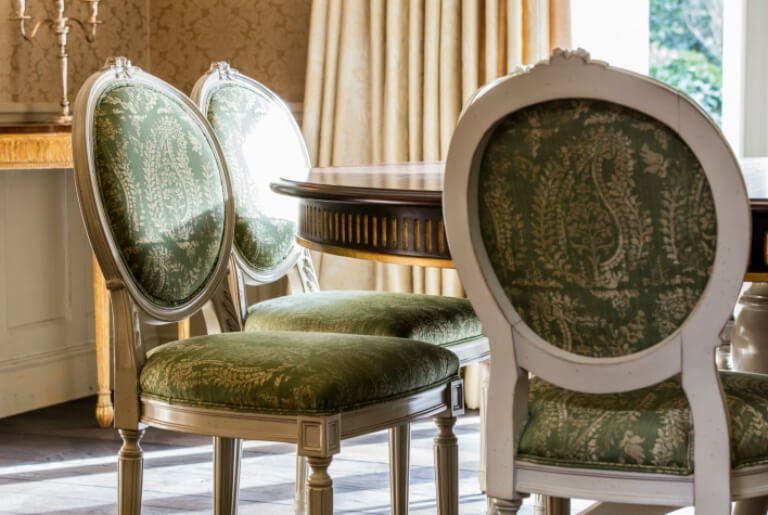 comfy and timeless antique furniture in green colour