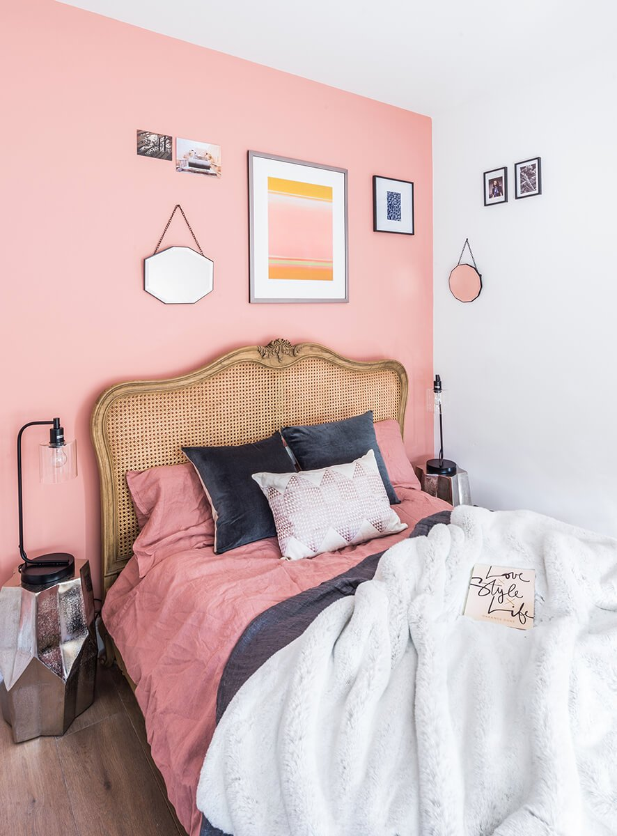spacious and bright bedroom with pink wall and designer furniture in Shepherd's Bush, London