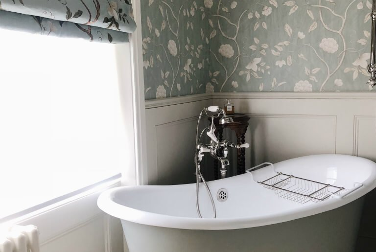 full renovation of bathroom in traditional style with floral roller blinds, wallpapers in St. John's Wood, London