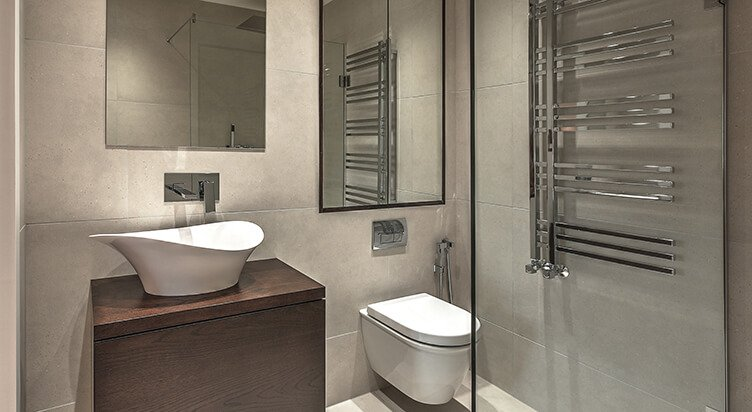 Contemporary design master en-suite with chrome sanitaryware, glass shower screen and large mirrors