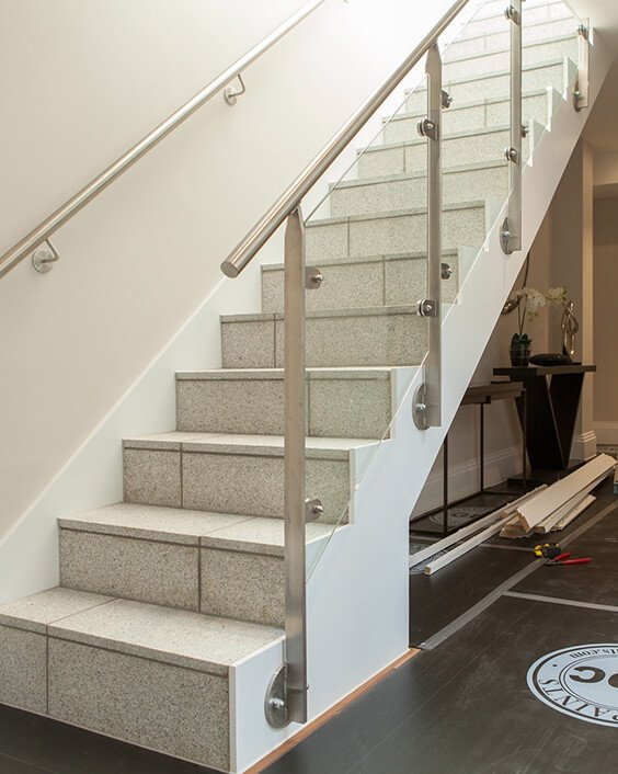 London property renovation process, staircase with steel and glass handrail