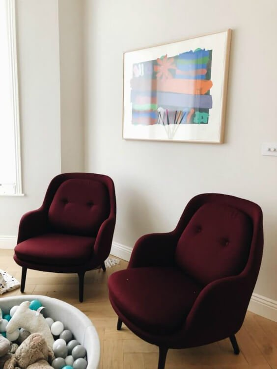 residential interior design for a living room with stylish burgundy armchairs in Bromley London