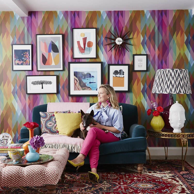 Fun, colourful, interior decorated reception room with eclectic accessories, colourful patterned wallpaper and artwork