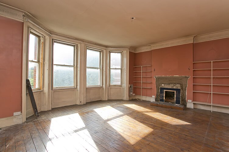 Before image of a spacious Kensington apartment reception room stripped down and ready for fit out