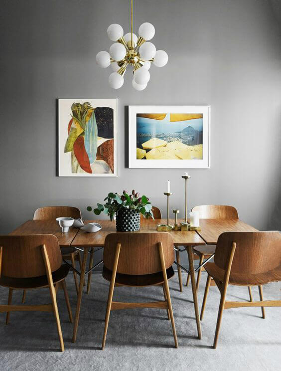 dining area in grey palette with wooden furniture
