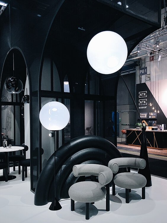 black interior design with grey armchairs by Tom Dixon studio spotted by TEMZA design and build in Stockholm