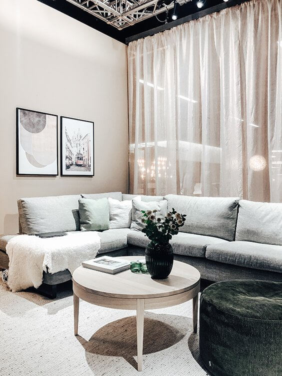 scandinavian interior design in earthy tones with large comfy sofa, small coffe table spotted by Temza in Stockholm
