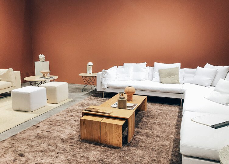 scandinavian interior design with rusty walls, large white sofas, coffe tables spotted by Temza in Stockholm