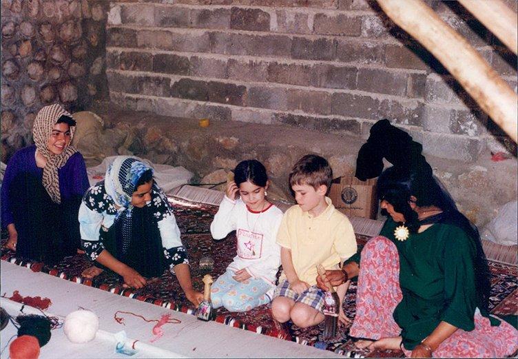 family make Persian rugs in Iran