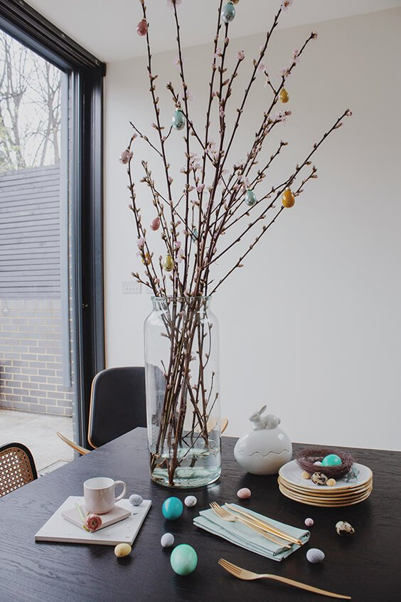 charming table decorations for easter with cherry blossom brunches, eggs and easter bunny