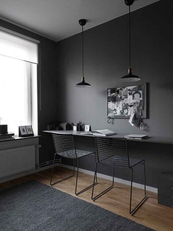 interior design for an office with dark grey walls and minimal work space