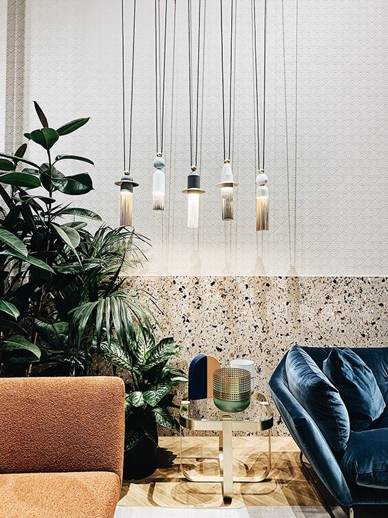 light interior design with mustard and blue couches and stylish glass coffe table spotted by Temza at Milano design week 2019