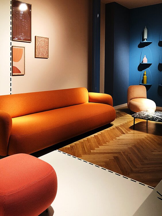 stylish interior design with peach pink chair, orange couch, blush and blue walls spotted by Temza at Milano Design Week 2019