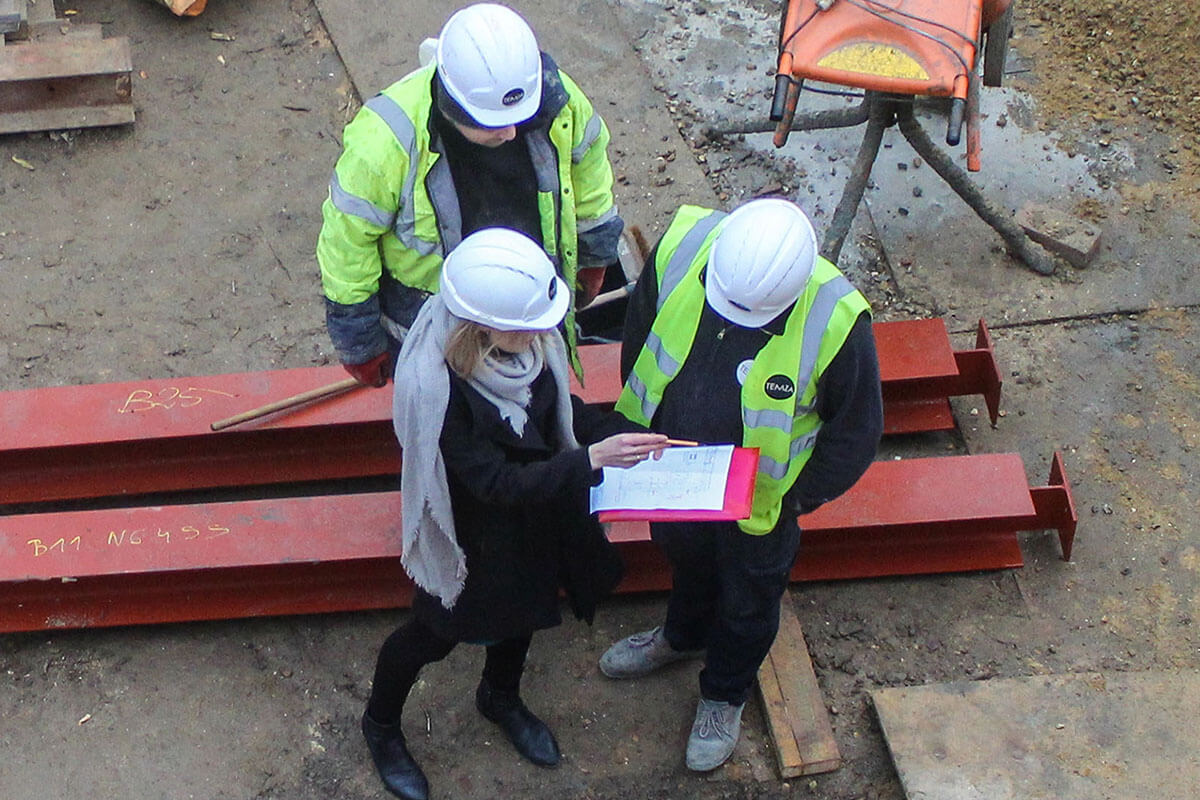 temza design and build construction team is discussing temporary works