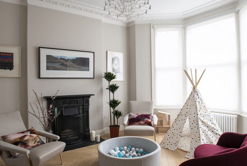 living room with burgundy armchairs, kids wigwam