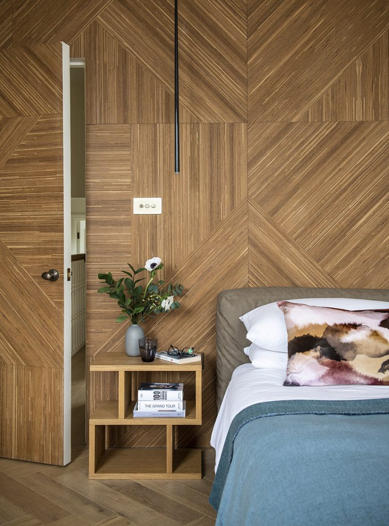 Master bedroom with wooden panel wall